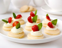 Many mini tarts with berries royalty free stock photography