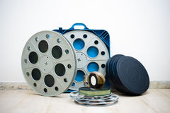 Many 35 mm cinema movie reel with boxes Stock Photo