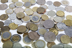 Many modern coins of different countries. On a white surface Royalty Free Stock Photography