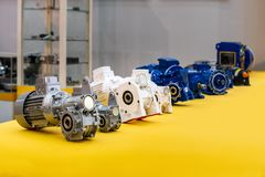 Many modern of high technology worn gears motor on yellow table for industrial stock photography