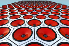 Many modern red speakers on wall, floor. Many red cool modern speakers on wall, dance floor Royalty Free Stock Photos