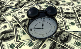 Many money and alarm clock Stock Images
