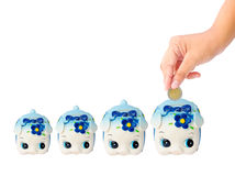 Many Money Saving with Piggy bank on white background Royalty Free Stock Photo