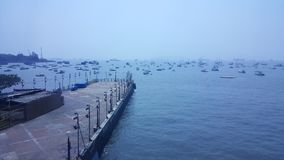 Many motor boats in Mumbai sea near jetty. Large number of motor boats and fisherman boats float in cool weather in the harbor near Gateway of India sea front royalty free stock photos