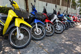 Many motorbikes at the parking. Near big store Royalty Free Stock Photography
