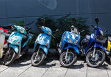 Many motorbikes at the parking. Near big store Royalty Free Stock Photo