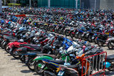 Many motorbikes at the parking. Near big store Royalty Free Stock Images