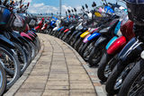 Many motorbikes at the parking. Near big store Stock Image