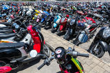 Many motorbikes at the parking. Near big store Stock Photography