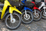 Many motorbikes at the parking. Near big store Royalty Free Stock Image