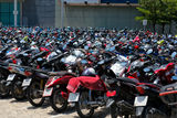 Many motorbikes at the parking. Near big store Stock Images