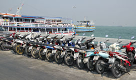 Many motorbikes at the parking on the waterfront. Royalty Free Stock Photo