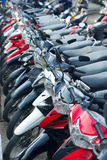 Many motorbikes on street parking Stock Images