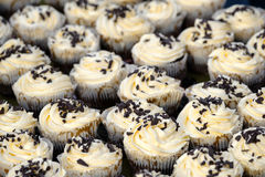 Many muffins with white crem Stock Photography