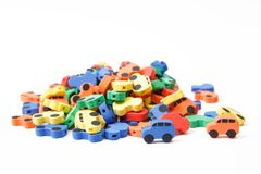 Many multi-colored cars on a white background, isolated. Car dump. royalty free stock images