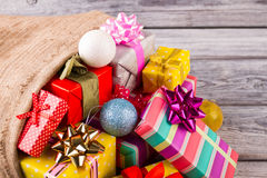 Many multi-colored gifts in sackcloth. stock photography