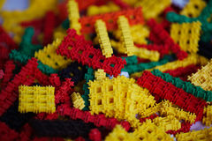 Many multi-colored plastic pieces Stock Image