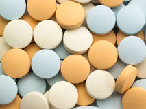 Many multi-coloured pills. Stock Photography