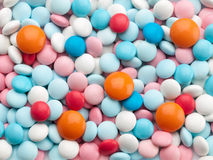 Many multi-coloured pills. Royalty Free Stock Photography