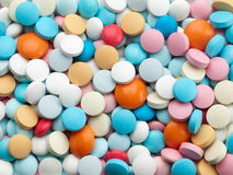 Many multi-coloured pills. Stock Image