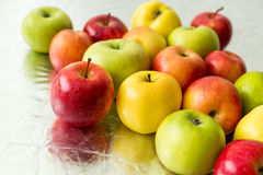 Many multicolor apples Stock Photos