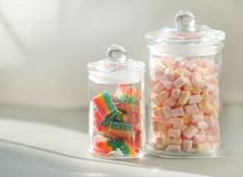 Many Multicolor candied sweet Fruit Jelly and marshmallows in glass stock image