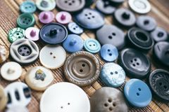 Many multicolored buttons on a brown background Royalty Free Stock Image