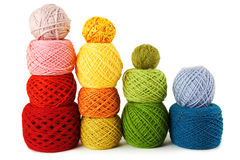 Many multicolored clews in a vertical rows Stock Image