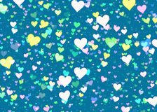 Many multicolored hearts on blue background Stock Photos