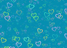 Many multicolored hearts on blue background Royalty Free Stock Images
