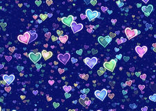 Many multicolored hearts on blue background Stock Photo