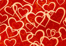 Many multicolored hearts on red background Stock Photography