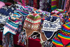 Many multicolored knitted hats Stock Photography