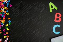 Many multicolored letters isolated on blackboard stock image