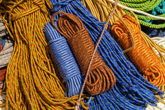 Many multicolored ropes lie on the ground Royalty Free Stock Photo