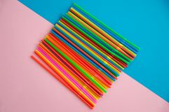 Many multicolored tubes for a cocktail copy. Plastic material, plastic tubing for drinking liquid royalty free stock photography