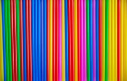 Many multicolored tubes for a cocktail copy. Plastic material, plastic tubing for drinking liquid. Background.  stock image