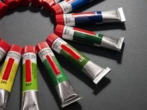 Many multicolored tubes with watercolors stock image