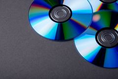 Many musical compact discs with a rainbow spectrum of colors as. Many musical clean compact discs with a rainbow spectrum of colors as a bright background Royalty Free Stock Photo