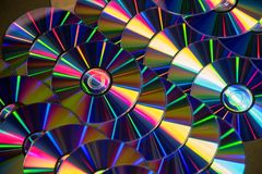 Many musical compact discs with a rainbow spectrum of colors as. Many musical clean compact discs with a rainbow spectrum of colors as a bright background Stock Image