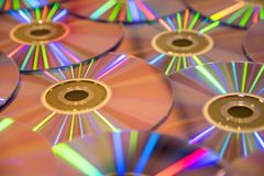 Many musical compact discs with a rainbow spectrum of colors as. Many musical clean compact discs with a rainbow spectrum of colors as a bright background Stock Photos