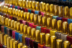 Many nail polish multicolor bottles arranged in rows background Royalty Free Stock Photos