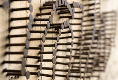 Many Nails nailed into wooden wall. Sticked out nails. Teamwork Royalty Free Stock Photos
