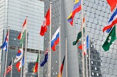 Many national flag and business building Stock Photos