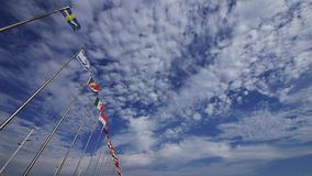 Many national flags fluttering in the wind against clouds background. Gh2_06687 stock video footage