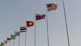 Many national flags fluttering in wind.American-flag. stock footage