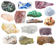 Many natural rocks and stones isolated on white. Many natural rocks and stones - lazurite, bauxite, eudialyte, alunite, schist, malachite, pyrite, quartz Royalty Free Stock Image