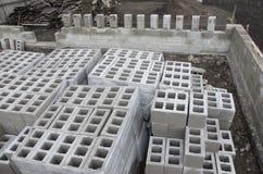 Many neatly folded gray cinder blocks background closeup. concrete mixer.  Stock Photography