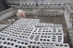 Many neatly folded gray cinder blocks background closeup. concrete mixer.  Royalty Free Stock Images
