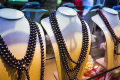 Many necklaces of pearl in store Royalty Free Stock Photography